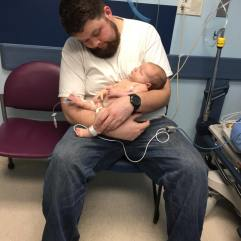 My husband holding Judah until we were placed in a room.